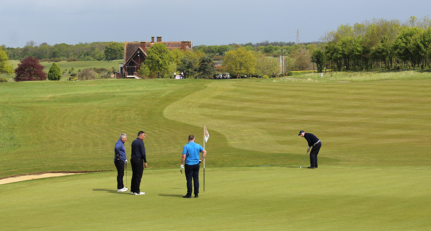 Four Men playing golf at Charity Golf Day