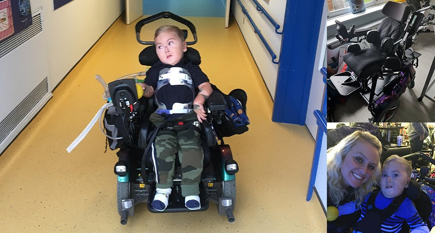 Child sitting in a mobility chair that has been donated to him.