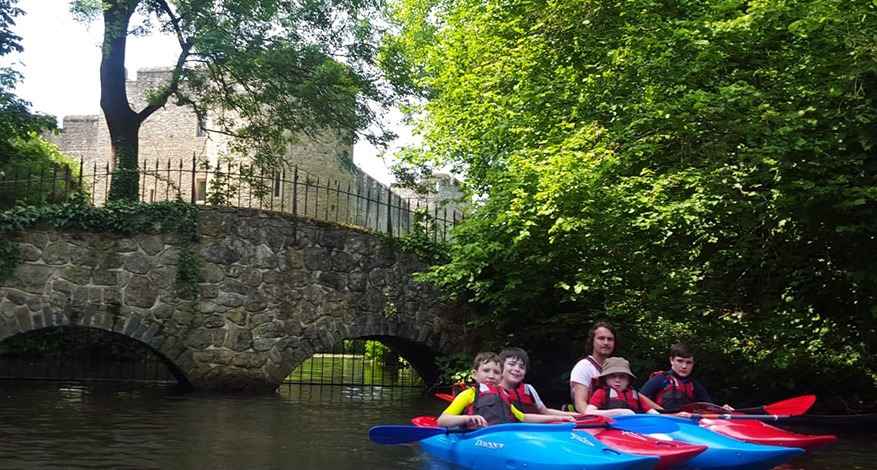 Stepney Scouts and scout leaders kayak down river.