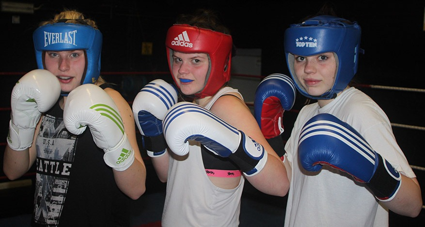 3 girls from Amateur Boxing Club, Swale Gloves pose in fight stance