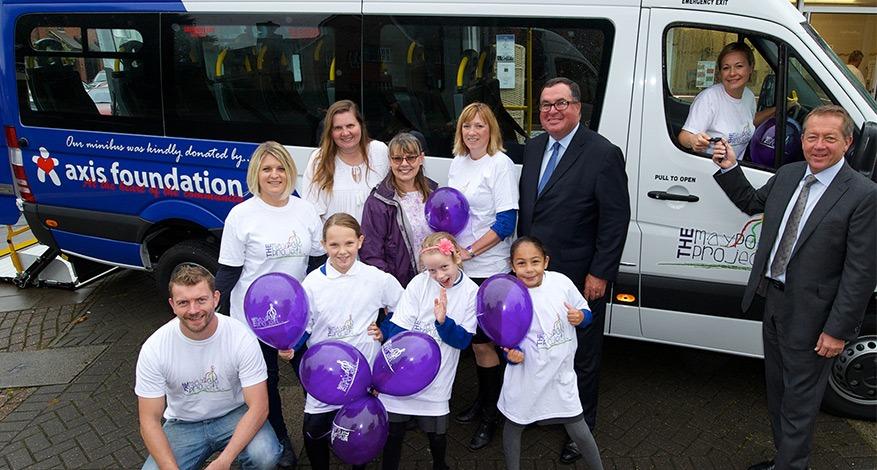 Axis CEO John Hayes handing over mini bus to Maypole charity