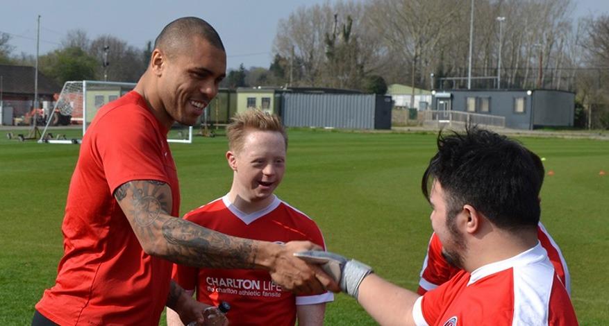 Footballer greets charlton upbeats players from charlton athletic community trust