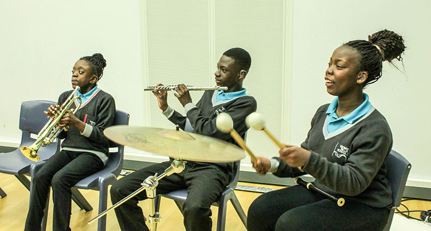 Children playing instruments at London Philharmonic Orchestra.