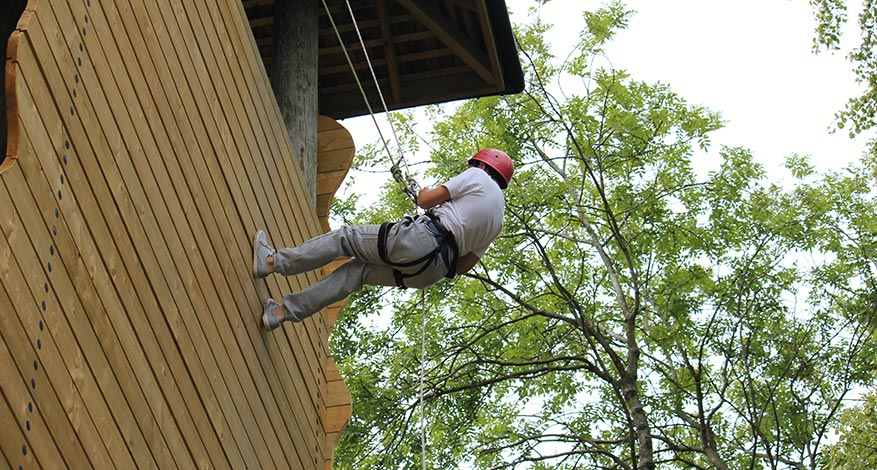 Child abseiling on residential trip with Purley Youth Project