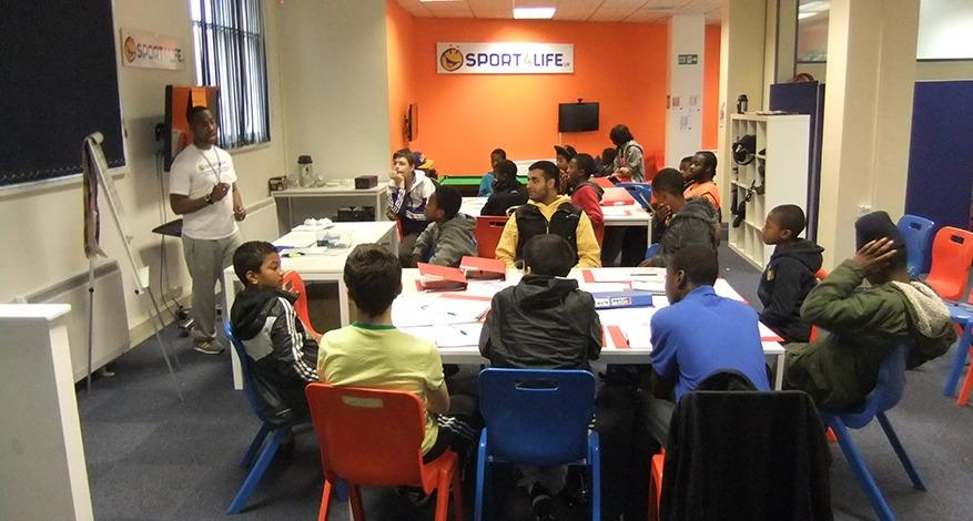 Man teaching life skills to disadvantaged children at Sport 4 Life