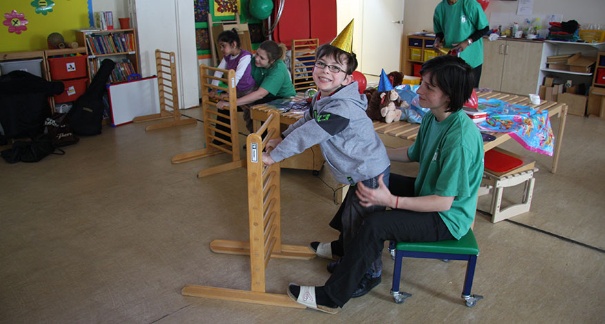 Children playing with carers from the London Centre for Children with Cerebral Palsy