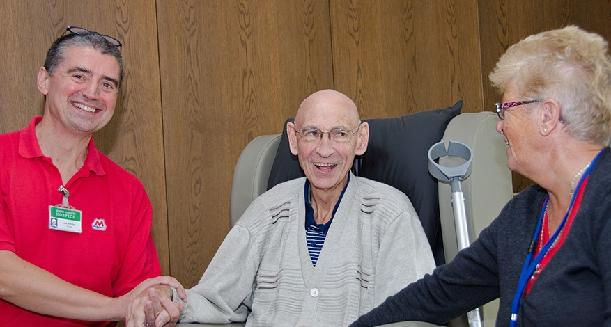 Elderly patient at North London hospice receives support from two carers