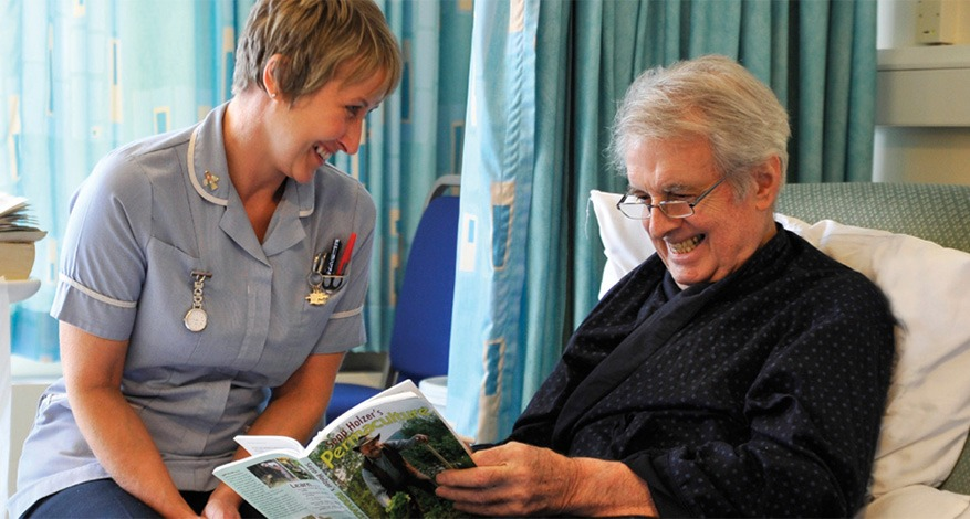 Elderly man on specialist mattress to help patients in palliative care at St lukes