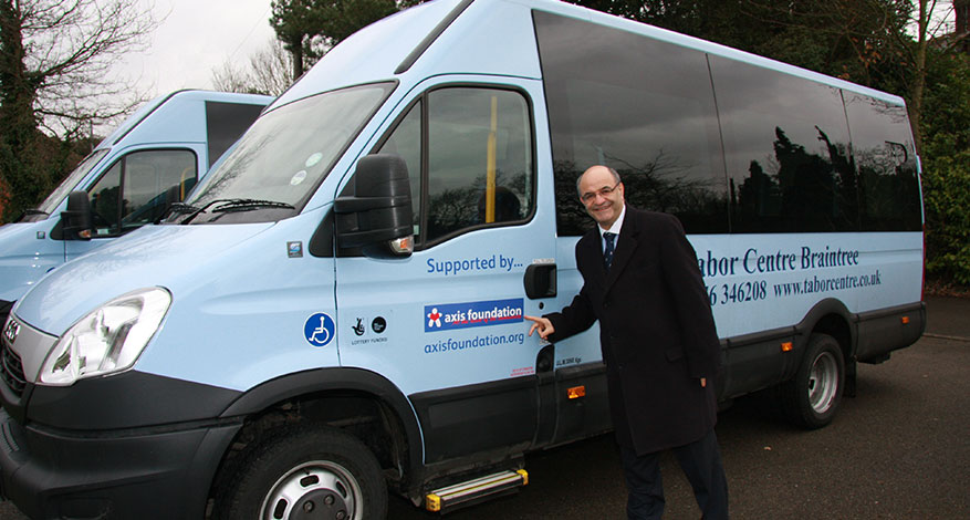Axis MD Joe Ibrahim hands over new mini bus to the Tabor Centre.