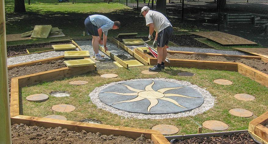 Volunteers help to build sensory garden for Corbets Tey School