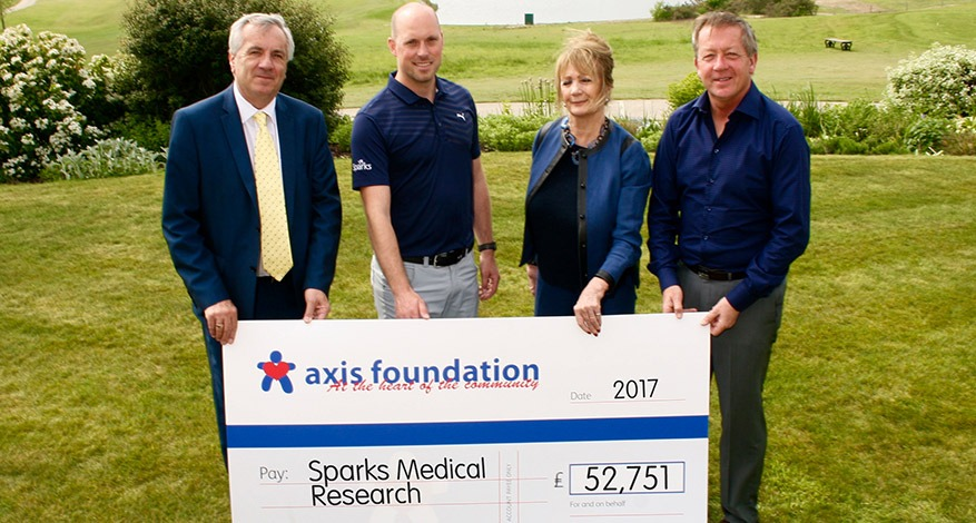 Axis Foundation Trustees giving a cheque to Sparks Medical Research Charity