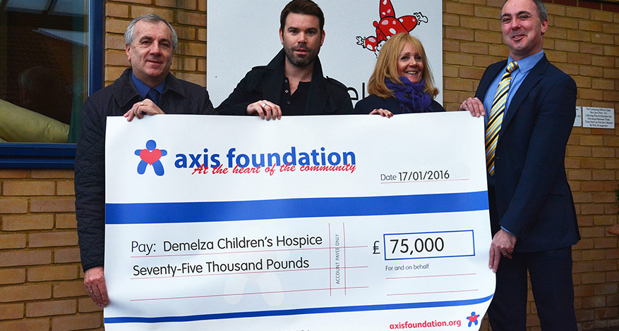 four adults holding axis foundation cheque for £75,000 for Demelza