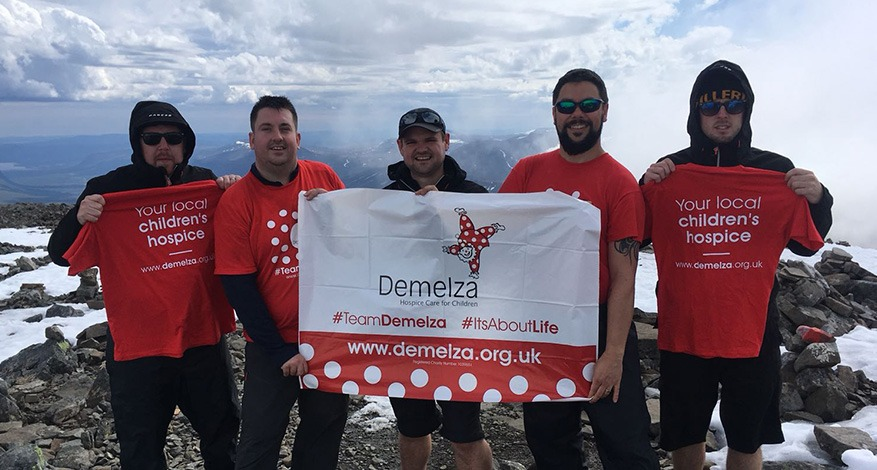 Five Men on summit of Arctic Mountain for Demelza Arctic Challenge Fundraiser