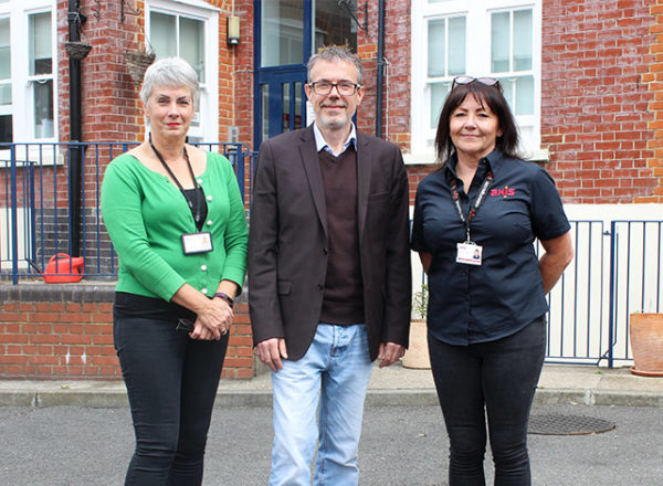 Three people in front of Alcohol and Drug Detoxification Centre with new accessible bathroom