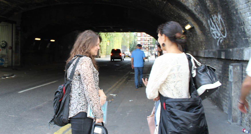 Two women standing in street working for charity creating routes out of prostitution