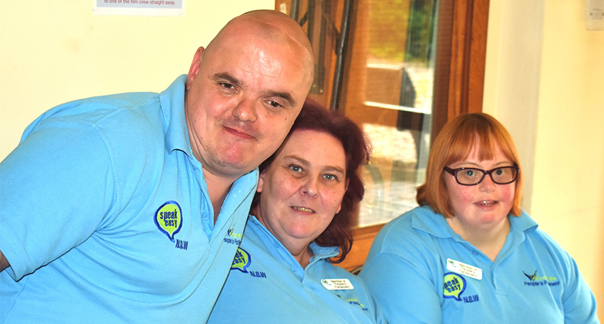 3 people with Speak Easy NOW (a self-advocacy charity) T-shirts