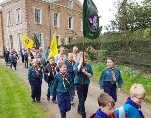Children in Scout Group walking down a path
