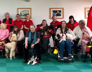 Group of Dog A.I.D service users and volunteers
