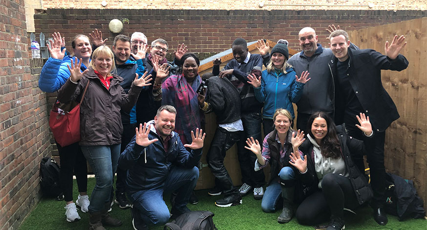 Group pictures of volunteers at one of WellChild's Helping Hands projects