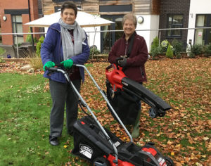 Two women at Rohan Gardens care home with gardening equipment