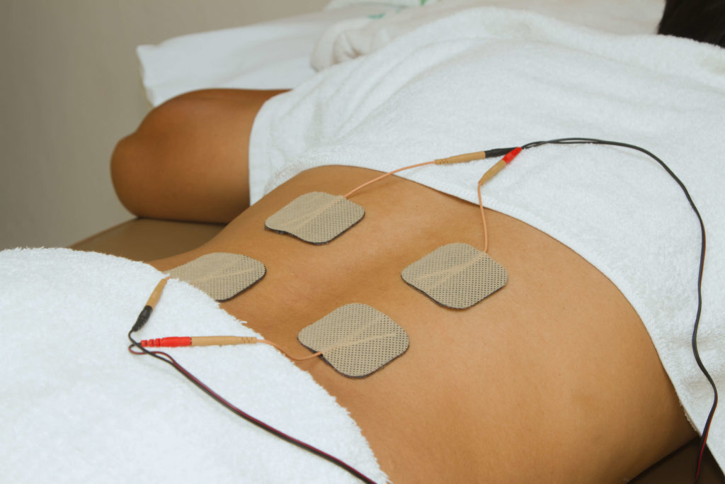 Patient using an FES machine in therapy