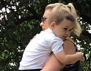 Mum holding baby, CASPA parents of children with autism