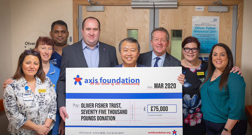 cheque presentation by the Axis Foundation to Oliver Fisher Trust