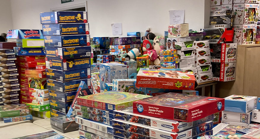 Warehouse full of Christmas gifts for children living in poverty