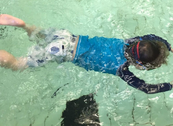 Young child having swimming lessons with Level Water