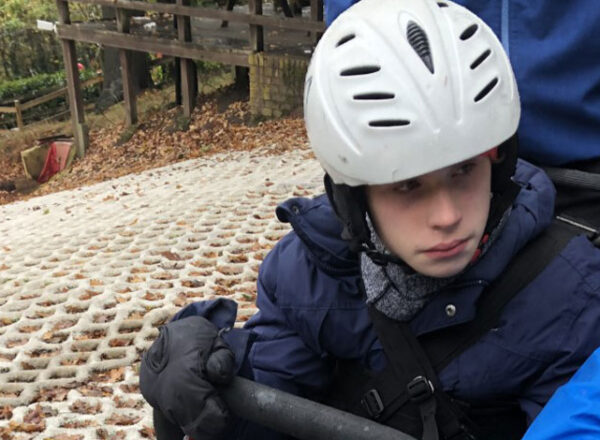 young boy on dry ski slope TAG adaptive snow sports