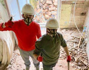 men on building site community centre Dads Lane
